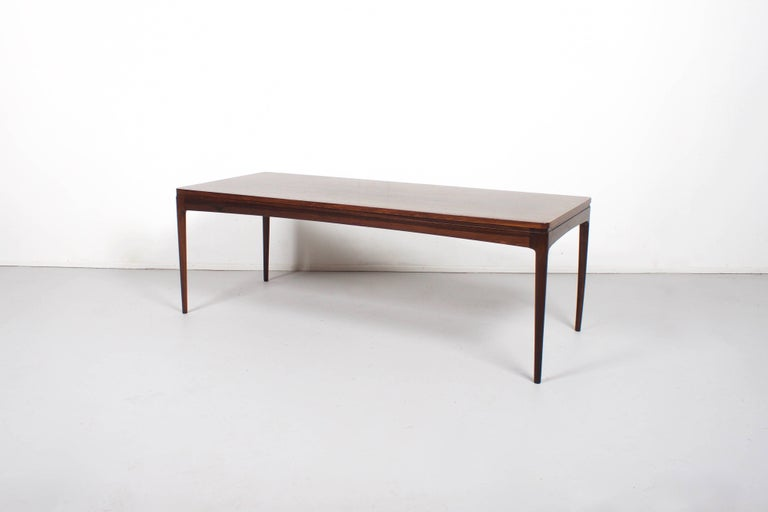 Coffee Table by Johannes Andersen in very good condition  Solid teak top and legs  The teak has a beatiful grain   While information on designer Johannes Andersen is limited and difficult to verify, it is believed that he was born in 1903 in Aarhus,