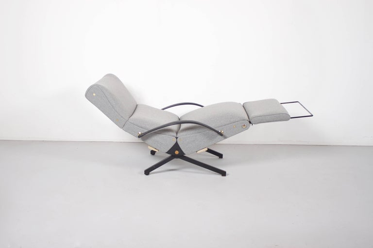 Beautiful P40 lounge chair by Osvaldo Borsani in very good condition.  Designed in 1954 for Tecno  The foam has been replaced and the chair has been reupholstered in a grey Divina fabric.  Black metal base with brass handles and