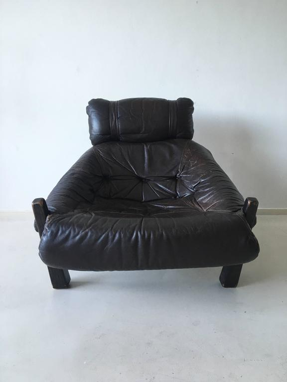 Comfortable lounge chair in style of Percival Lafer. This gorgeous design consists of a brown lacquered wooden frame and leather and fabric upholstery. Some signs of age and use. A few buttons missing. ON SALE!