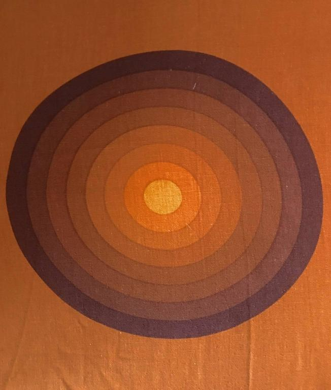 Vintage Verner Panton textiles or curtains, manufactured in Denmark, circa 1960s. These pieces feature a symmetric template of multilayered spheres or circles. These layers visually give a multi dimensional look. These textiles can be used as the