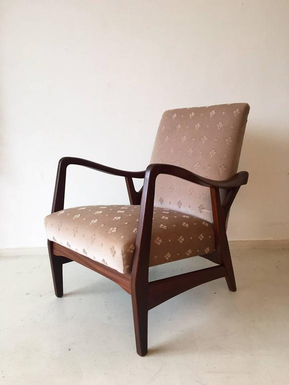 These stunning and heavy quality Dutch design chairs consist of a very high quality frame in Teak and feature the Original fabric. When you want the chairs to have a modern look (see: image 7), they can easily be reupholstered. This model is very