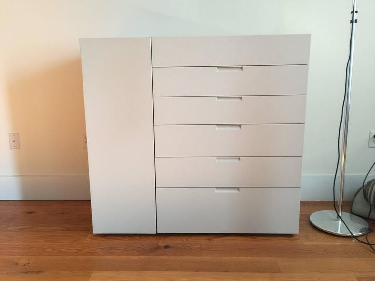 Modern Italian Sideboard - Cabinet made of a matt lacquered wood in ivory color featuring six drawers and one side door.    This modern Italian cabinet offered by Designitalia Mid Century Modern Furniture is full of lovely details. It features 6