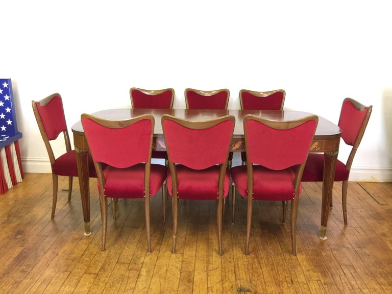 osvaldo borsani dining chairs with brass ornament and new red