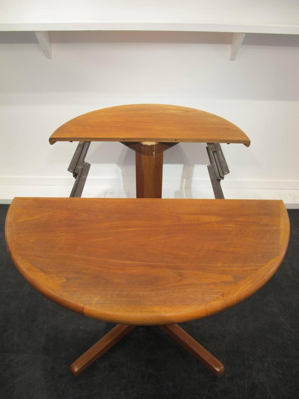 Danish Extending Teak Dining Table And Set Of Eight Danish