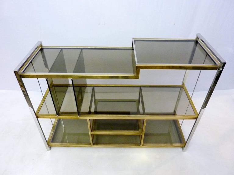 Console in brass, chrome and smoke colored glass designed by Serantoni & Arcangeli, Italy for New Ideas Inox.