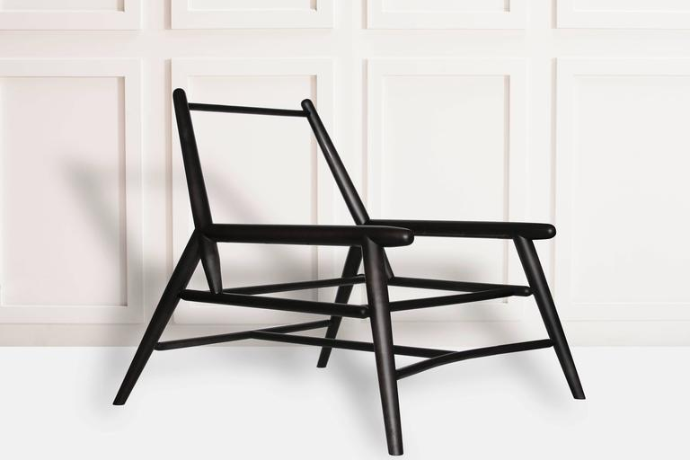 Made from maple and stained a rich black the sling chair is upholstered in our Japanese textile collection. The cotton or linen blend fabrics are hand made in Kyoto by master weavers Hosoo, a Japanese family owned company originated in 1866. The