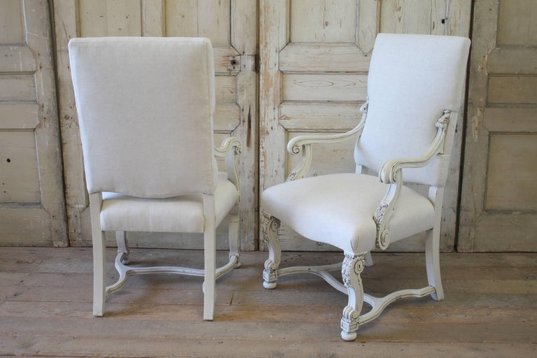 Beautifully upholstered Renaissance Revival dining chairs with delicate trim detail. This set includes six side chairs and two armchairs. Upholstered in a greige natural linen, color is oatmeal that leans more towards the grey side. You can linger