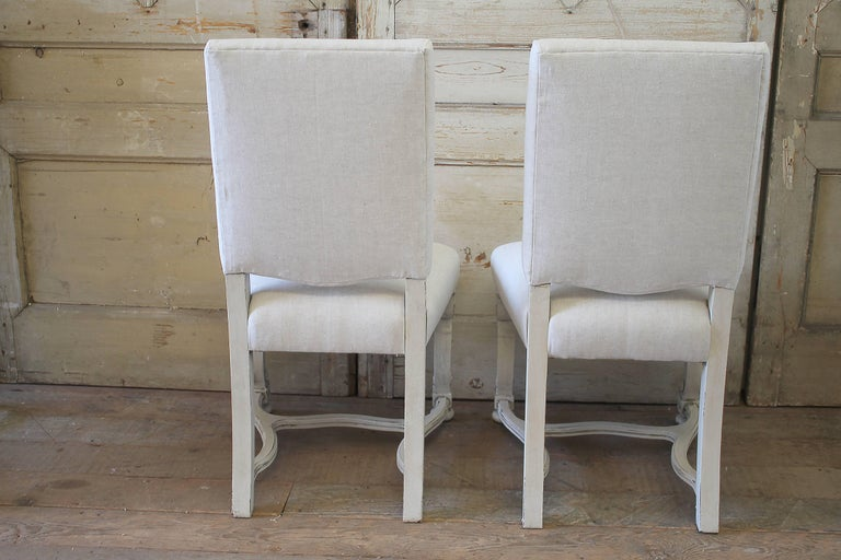 Set of Eight Carved and Linen Upholstered Renaissance Dining Chairs For Sale 1