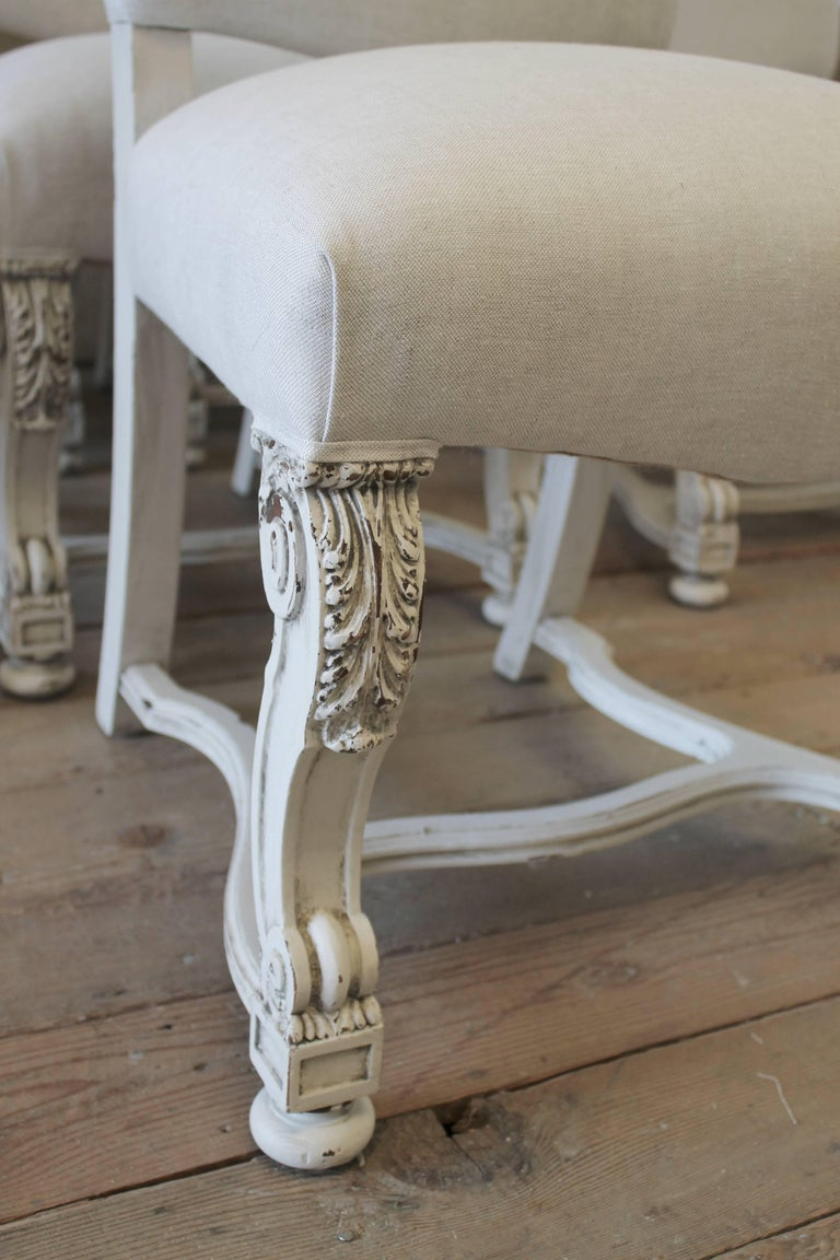 20th Century Set of Eight Carved and Linen Upholstered Renaissance Dining Chairs For Sale