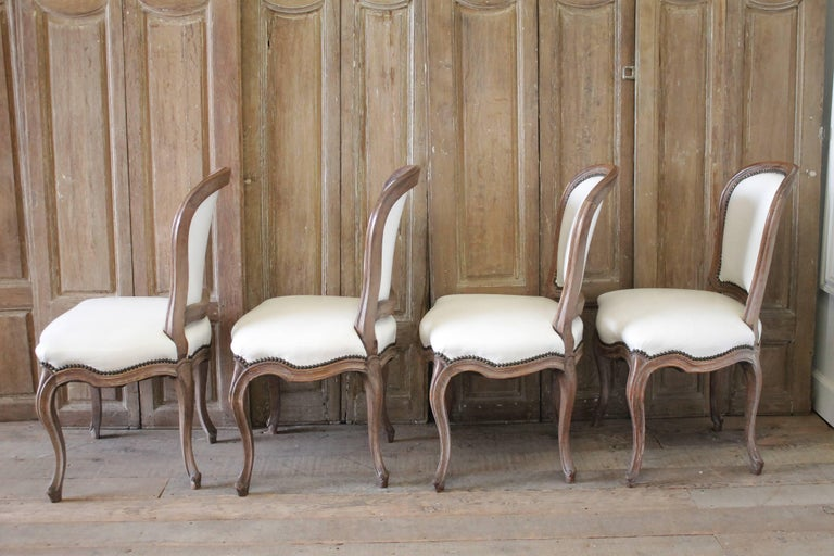 Set of Ten Early 20th Century Louis XV Style Dining Chairs in White Leather For Sale 1