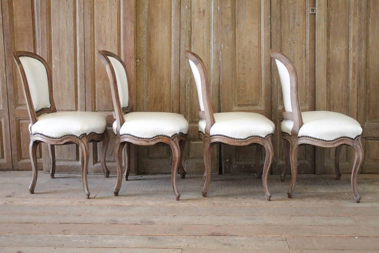 Set of Ten Early 20th Century Louis XV Style Dining Chairs in White Leather For Sale 6