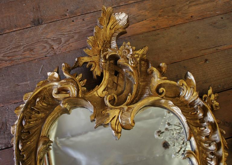 Late 19th century wood carved Rococo style mirrors. Mirrors are fully reflective. Ready to hang.