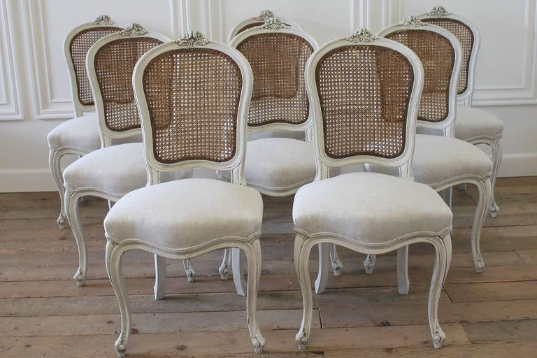 Beautiful set of dining chairs that have been painted in our signature  oyster white, with - Set Of Eight Vintage French Painted Cane Back Dining Chairs At 1stdibs