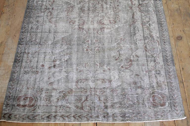 Gorgeous faded indigo, grey and rust colors running through out. Wool hand-knotted rug from the 1940s. Measures: 68