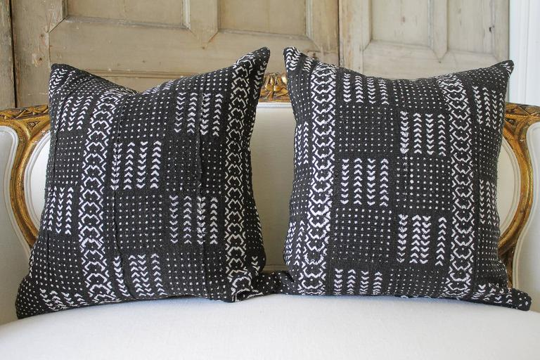 These are not reproduction, these are the real vintage mud cloth, finished front and back with the same materials, and zipper closure. Mud cloth cushion pillow sewn from handmade mud cloth fabrics from Mali. Topped with an all-over hand-dyed print