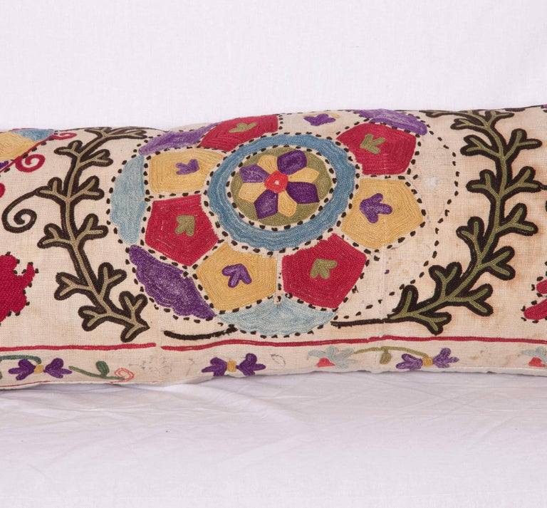 The pillow is made out of a late 19th century, Uzbek Bukhara Suzani. It does not come with an insert but it comes with a bag made to the size and out of cotton to accommodate the filling. The backing is made of linen. Please note 'filling is not