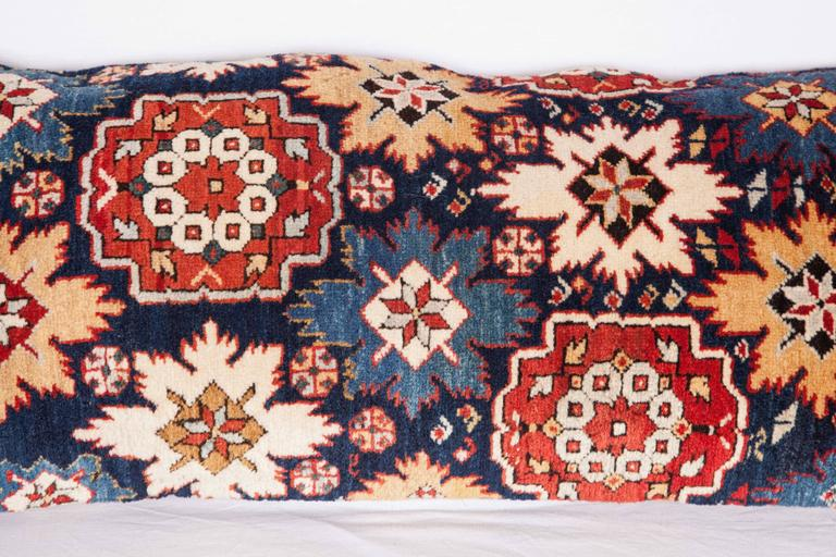 Pillow is made out of a 19th century fragment of a Caucasian Shriven rug. The pillow does not come with an insert but with a cotton bag made to the size to accommodate the insert material. The backing is made of linen. Please note filling is not