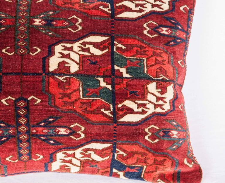 The pillow is made out of a early 19th century, Turkmen Tekke rug. It does not come with an insert but it comes with a bag made to the size and out of cotton to accommodate the filling. The backing is made of linen. Please note filling is not