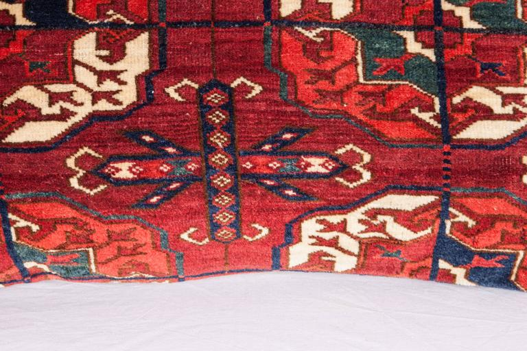 Wool Antique Pillow with Velvet like Texture Made Out of 19th Century Turkmen Rug For Sale