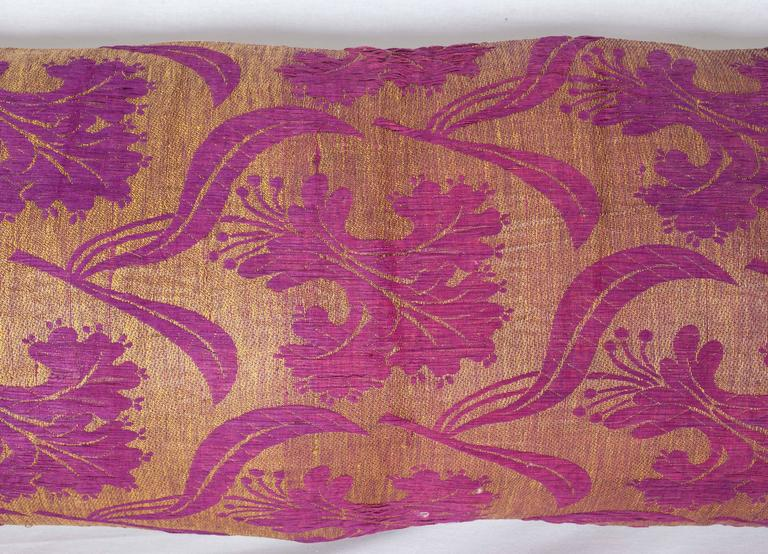 The pillow is made out of a late 19th ottoman Turkish silk brocade.  It does not come with an insert but it comes with a bag made to the size and out of cotton to accommodate the filling .  The backing is made of linen.    Please note filling is
