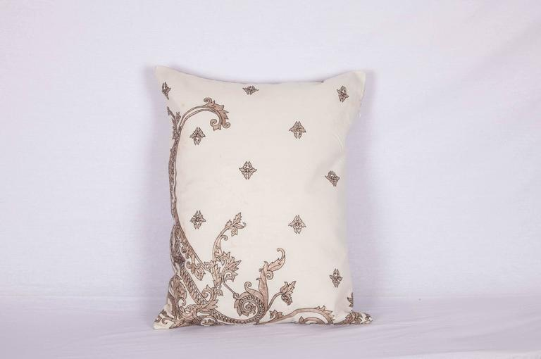 The pillow is made out of a 19th century or earlier European silver embroidery. It does not come with an insert but it comes with a bag made to the size and out of cotton to accommodate the filling. The backing is made of linen. Please note '