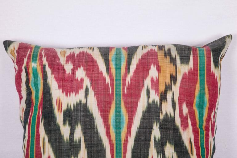 The pillow is made out of late 19th century, Uzbek ikat. It does not come with an insert but it comes with a bag made to the size and out of cotton to accommodate the filling. The backing is made of linen. Please note 'filling is not provided'.
