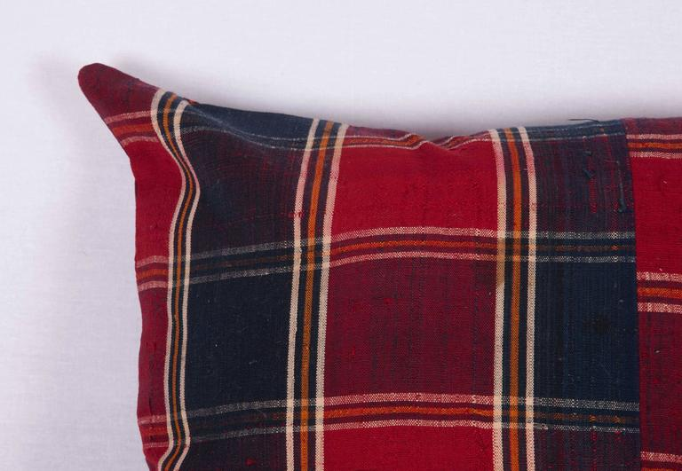 The pillow is made out of mid-20th century, Turkmen silk shawl. It does not come with an insert but it comes with a bag made to the size and out of cotton to accommodate the filling. The backing is made of the same fabric. Please note ' filling is
