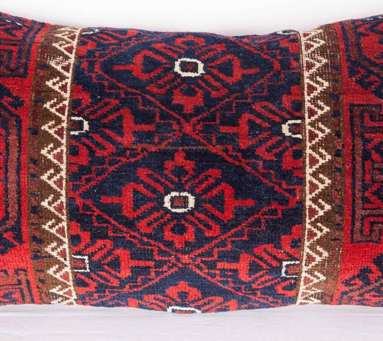 The pillow is made out of a late 19th century, Baluch rug fragment. It does not come with an insert but it comes with a bag made to the size and out of cotton to accommodate the filling. The backing is made of linen. Please note filling is not