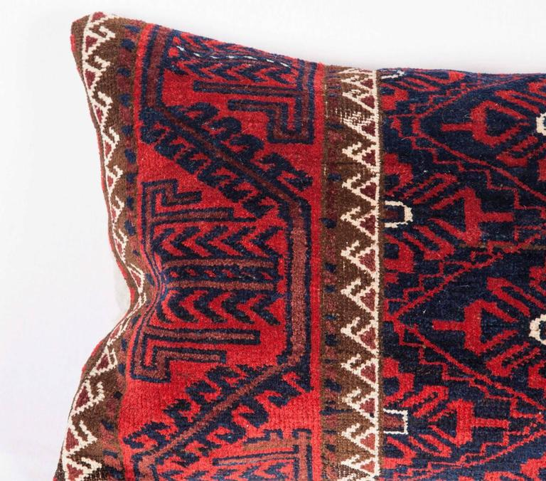 Tribal Antique Pillow Made Out of a 19th Century Baluch Rug Fragment For Sale