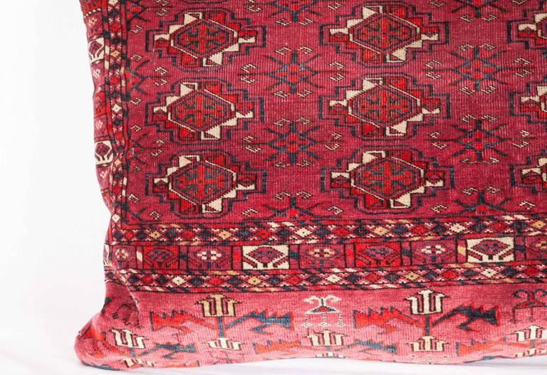 The pillows were made out of a 19th century, Turkmen Tekke tribe chuval / bag. It does not come with an insert but it comes with a bag made to the size and out of cotton to accommodate the filling. The backing is made of linen. Please note filling