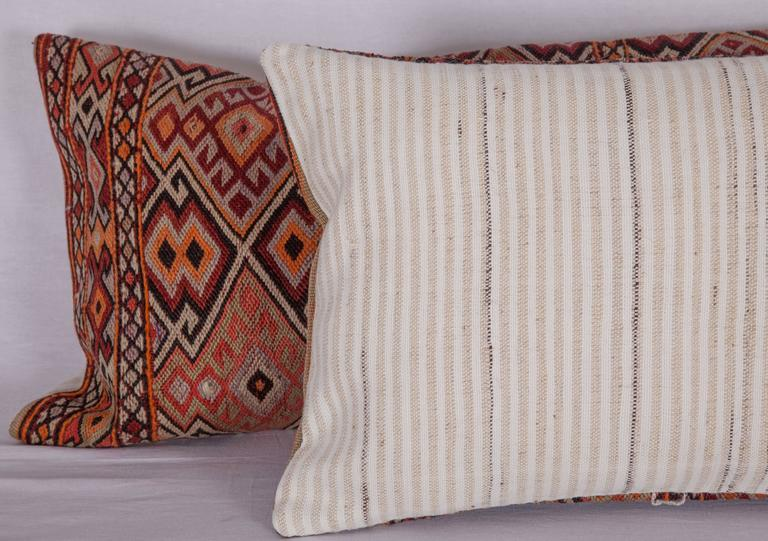 Pillows are made from an Anatolian Sumak Kilim. They do not come with inserts but come with bags made to the size to accomodate insert materials. Hand loomed vintage cotton and wool fabric in the back.  dry clean only.