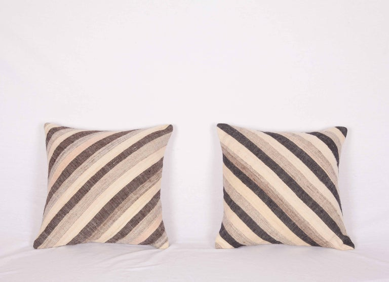 The pillows are made out of a mid-20th century, Turkish Kilim. They do not come with an insert but they come with a bag made to the size and out of cotton to accommodate the filling. The backing is made of linen. Please note filling is not provided.