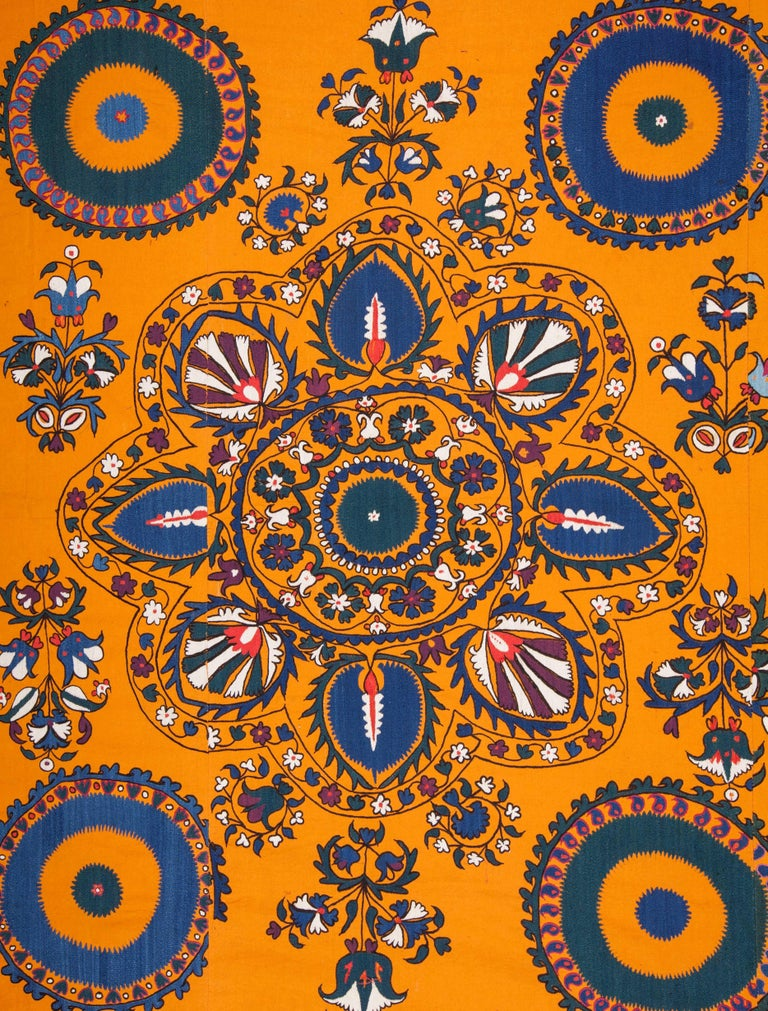 Suzani has well saturated colors and a very finely done embroidery.  'Suzani' meaning 'needle' so 'needle work ' in Persian, refgers to a group of embroideries mainly done in Central Asia, in countries such as, Uzbekistan, Tajikistan. Suzanies in