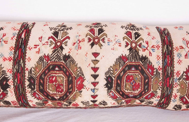 Pillow case is made from an antique 19th century Macedonian Greek embroidery. It does not come with an insert but comes with a bag made to the size and out of cotton to accommodate the filling. The backing is made of linen. Please note filling is