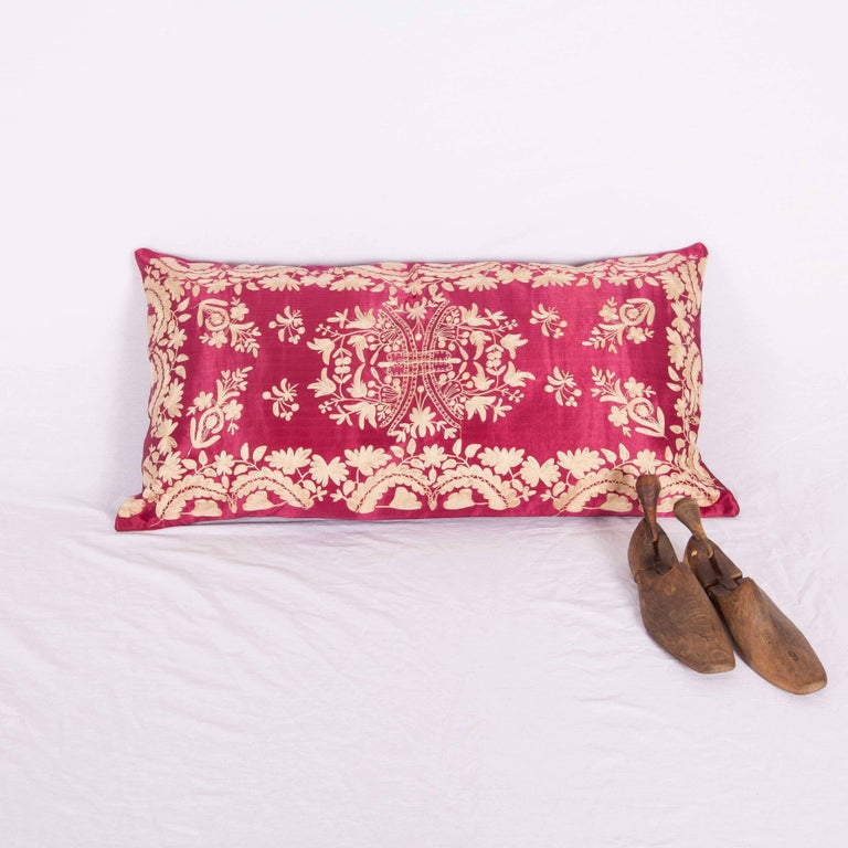 Late 19th / early 20th C pillow , embroidered in silk on a satin silk background. The backing has been replaced with a hand loomed silk and cotton fabric. Insert is not provided but it comes with a bag to accomodate insert material . Dry Clean  or