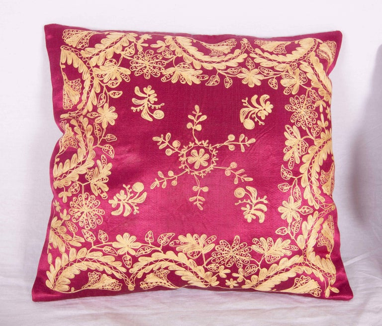 Late 19th / early 20th Century pillow cases , embroidered in silk on a satin silk background. The backing has been replaced with a hand loomed silk and cotton fabric. Insert is not provided but it comes with a bag to accommodate insert material .