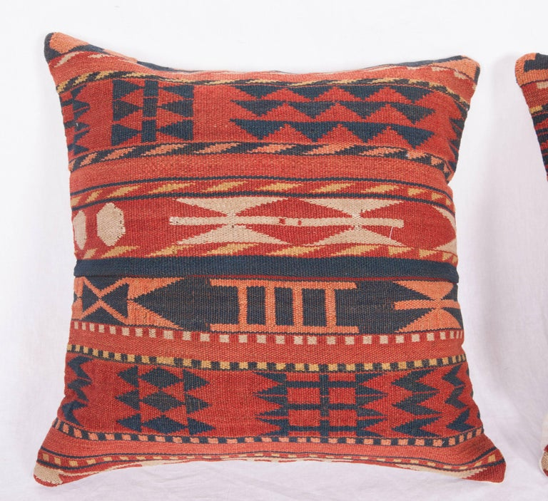 Pillow cases were made from a late 19th Century Uzbek Gudjeri kilim. The backing fabric is Vintage Turkish wool and cotton hand loomed fabric.  They do not come with inserts. spot cleaning or dry clean only