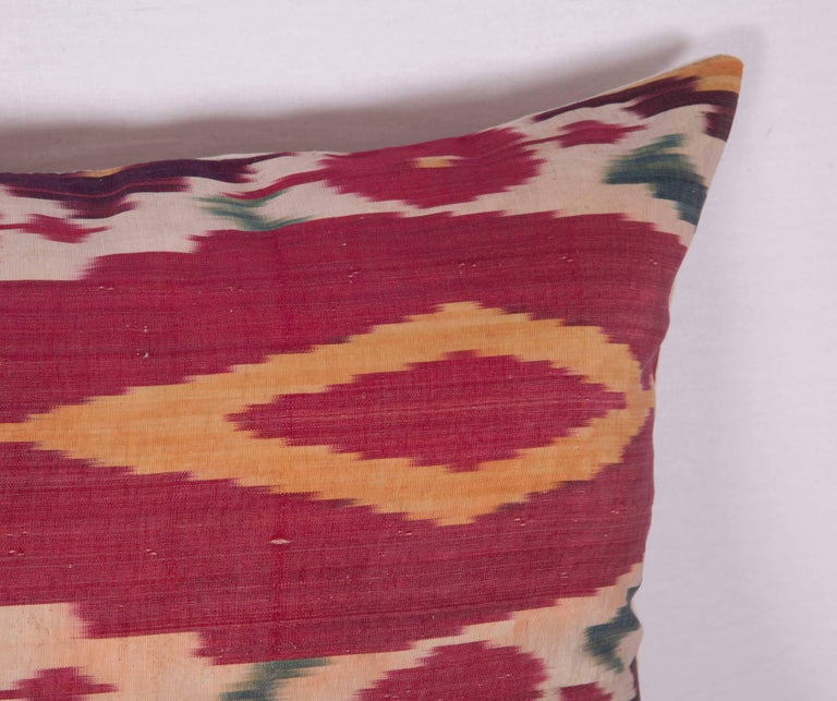 Tribal Antique Ikat Pillow Case Fashioned from a 19th Century Uzbek Ikat For Sale