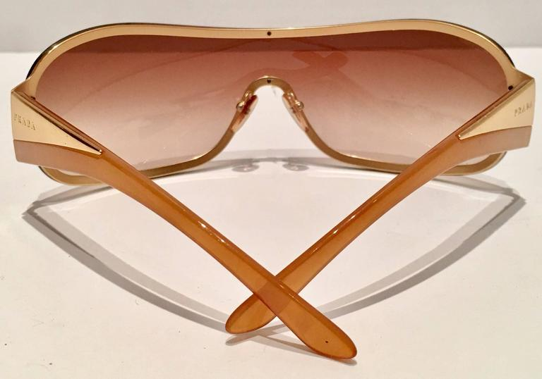 b2065a85f5 Vintage Prada Sport Gold Shield Sunglasses at 1stdibs