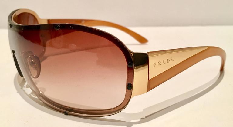 e6f16427a0 Vintage Prada Sport Gold Shield Sunglasses In Excellent Condition For Sale  In West Palm Beach
