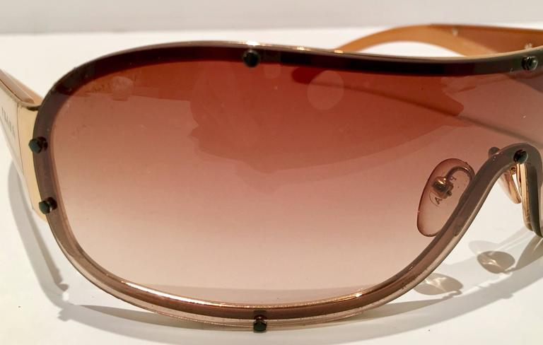 f29f6f41eb Contemporary Vintage Prada Sport Gold Shield Sunglasses For Sale