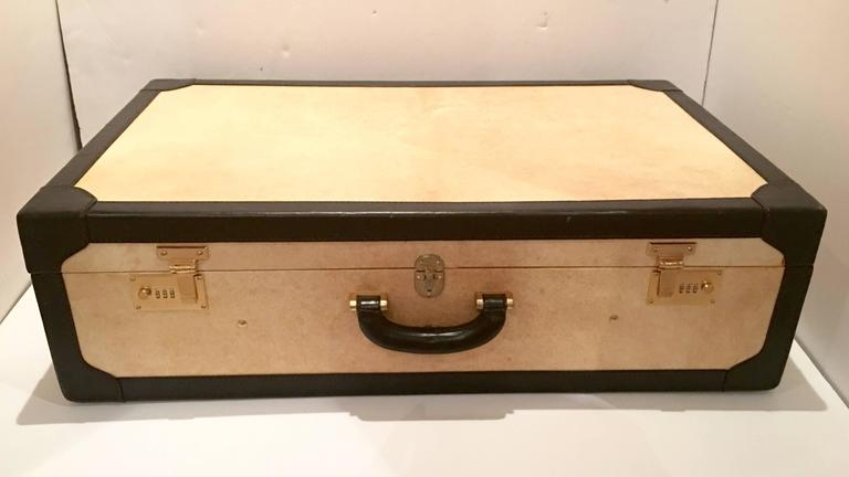 1950's butter soft cream vellum and black leather strap Italian suitcase in the style of T. Anthony made for Barney's New York. Impeccable craftsmanship that only the Italian leather makers know how to fabricate with exquisite stitching details.