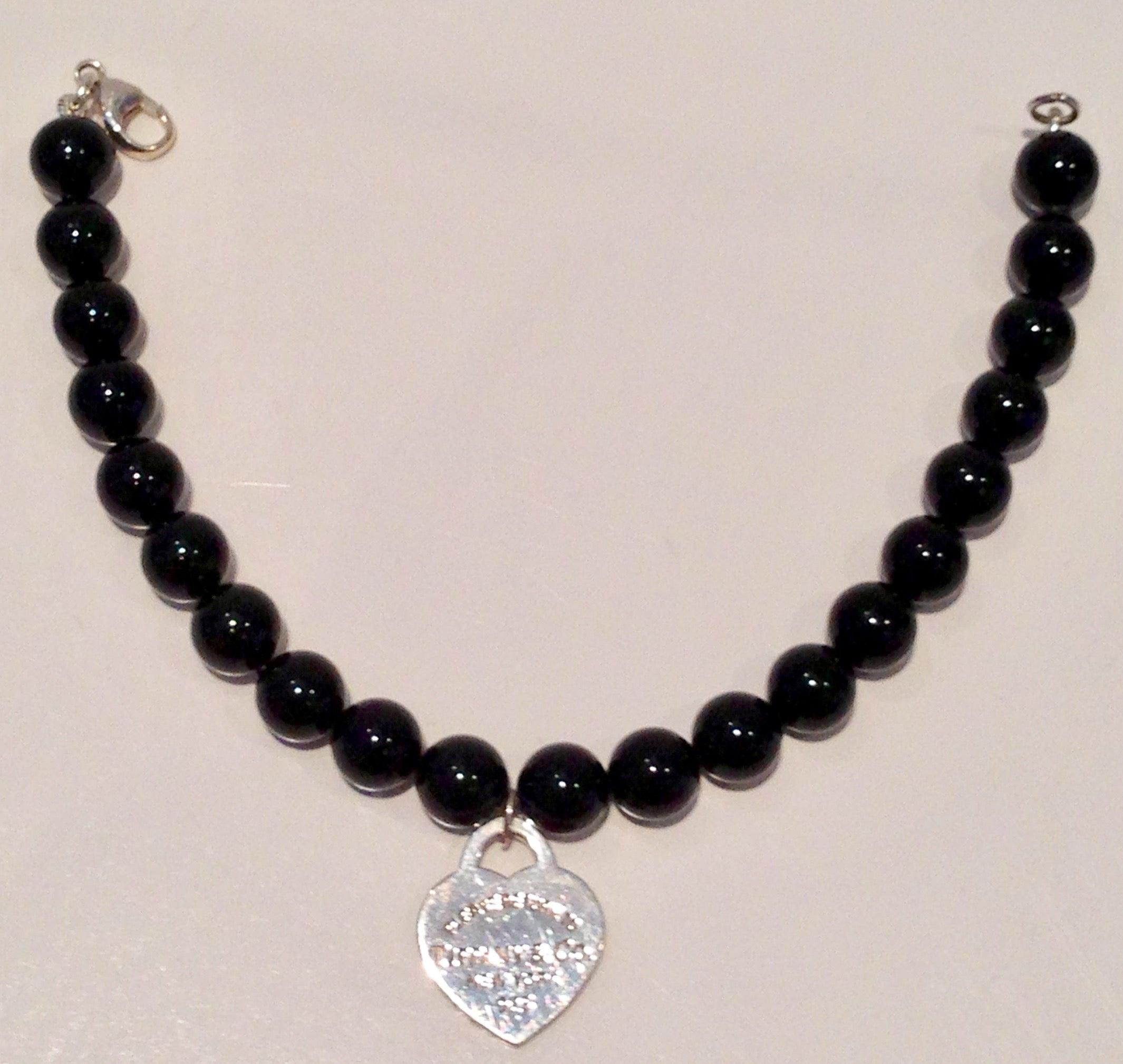 988cc33bb014 Tiffany and Co. Silver Heart Tag 7.5  Black Onyx Bead Bracelet at 1stdibs