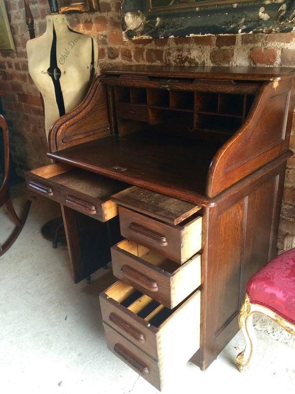 A large Edwardian solid oak roll top desk, with one small drawer and  various pigeon - Antique Roll Top Desk Oak Writing Desk Edwardian At 1stdibs