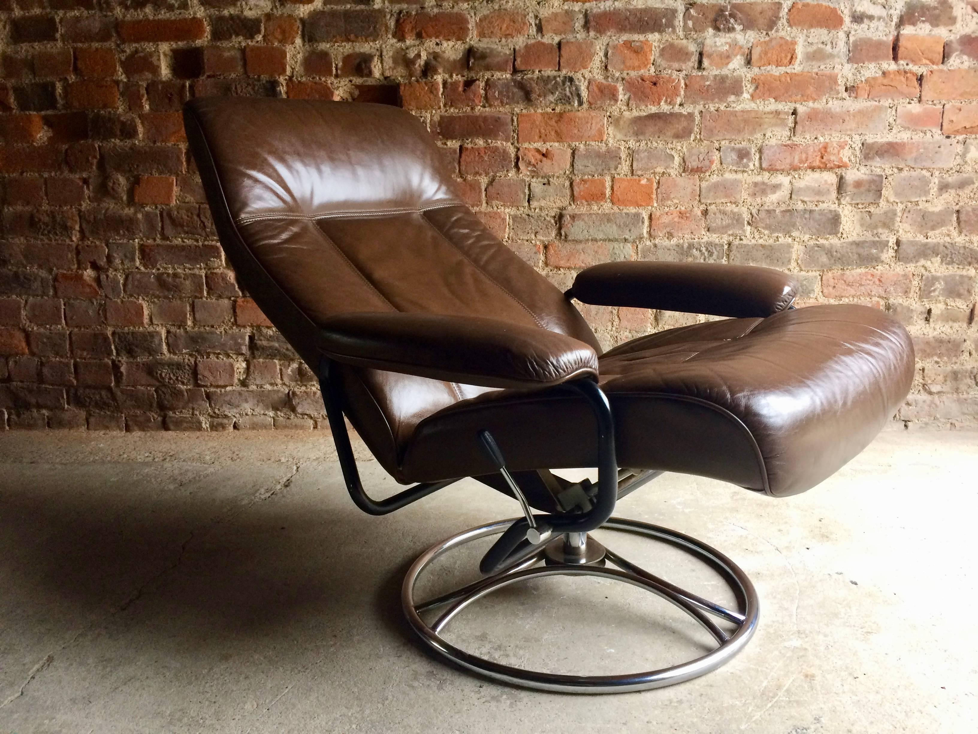 A Magnificent Mid Century, 1970s, Swedish Leather Reclining Swivel Armchair  With Chromed Metal