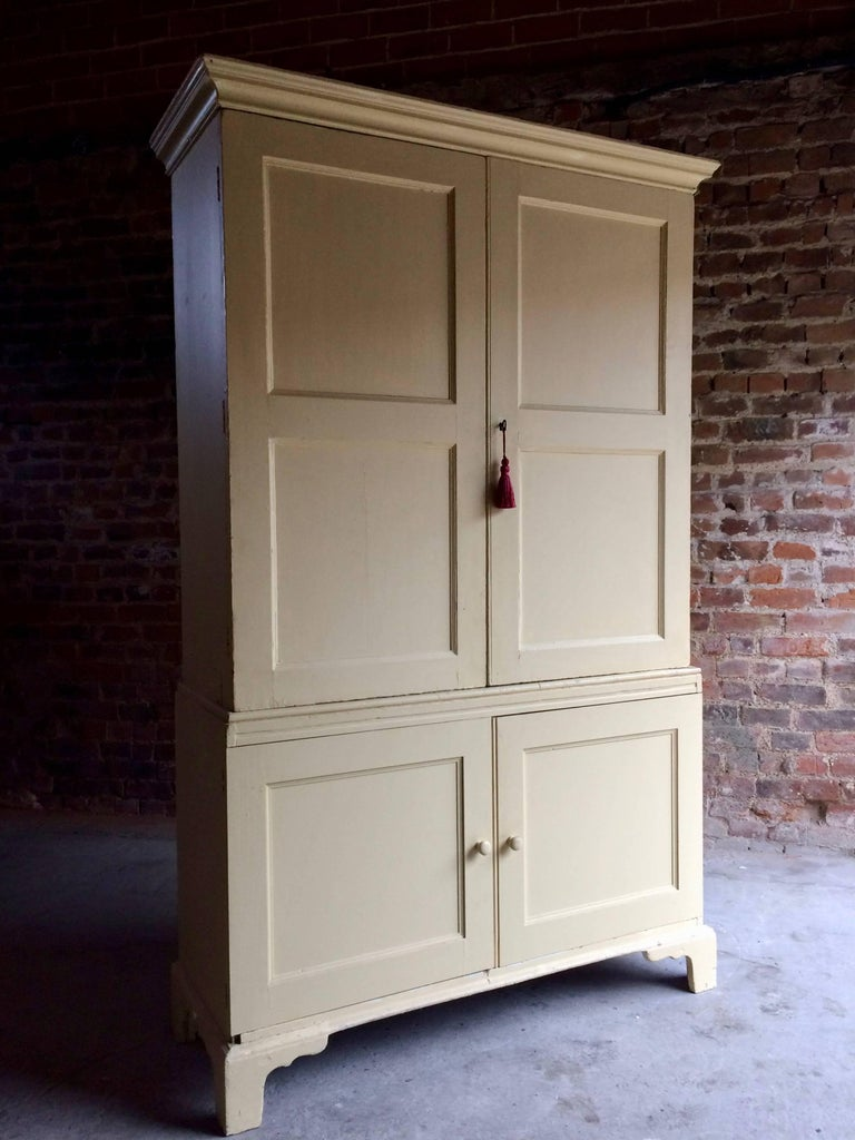 A gorgeous looking antique Georgian pine linen cupboard with later painted  'Buttermilk' finish, - Antique Housekeepers Cupboard Linen Press Pine Georgian, 19th