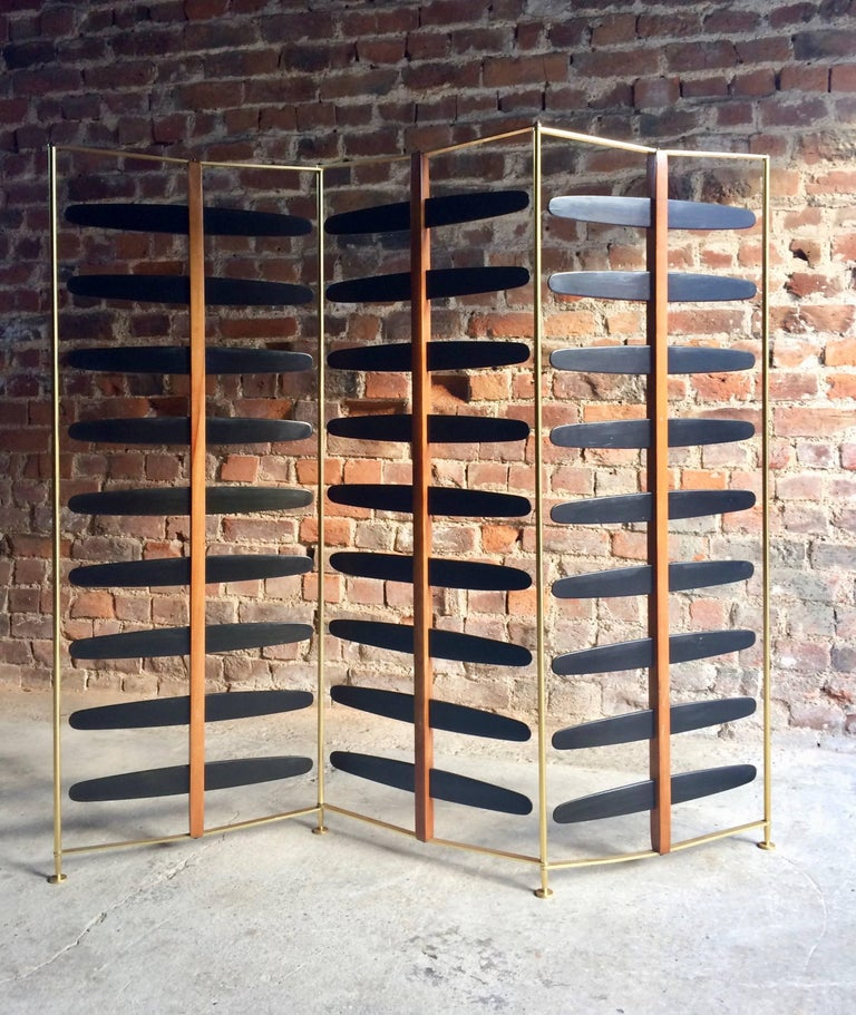 Magnificent midcentury three-section room divider or screen, probably of French design and origin dating to circa 1950s-1960s, brass three section frame with ebonised wooden wings to each section, very beautiful and extremely stylish.