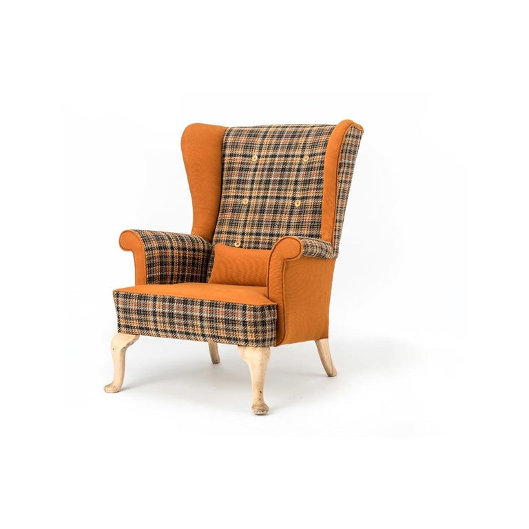 Original Parker Knoll unique fireside wing chair reupholstered in a funky 'Autumn Nut' tweed with contrasting Toffee panels with 6 burnt wooden deep buttoned back detail and resting on original sanded legs. Complete with contrasting scatter cushion