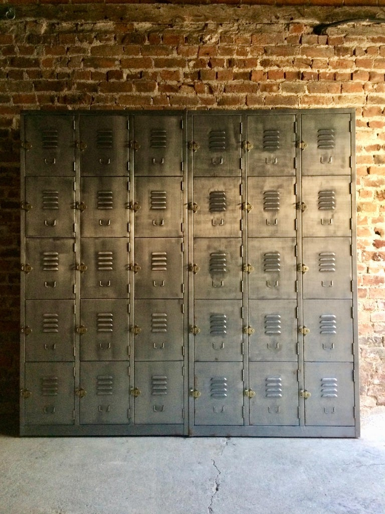 Fabulous set of two x three row industrial banks of buffed steel lockers of exceptional quality and style, each set of lockers with five individual compartments each with brass pull handles and index card holder, can be used individually or in a