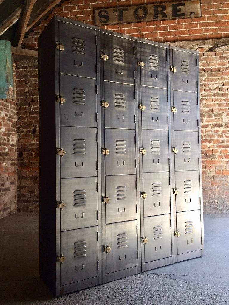 Fabulous set of two x 10 cabinet (total 20 cabinets)  industrial buffed steel lockers of exceptional quality and style, each set of lockers with ten individual compartments each with brass pull handles and index card holder, can be used individually